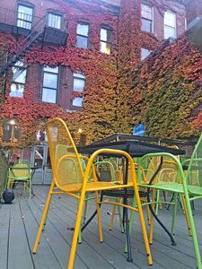 yellow and green chairs at an outdoor cafe in Portland