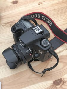 Canon EOS 60D SLR camera on a wood surface
