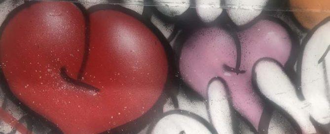 graffiti hearts spray painted onto a wall