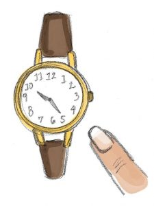 finger pointing at a watch