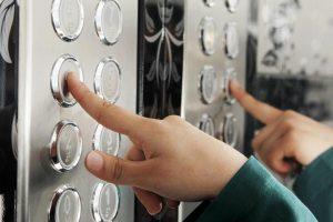 kid pushing elevator button