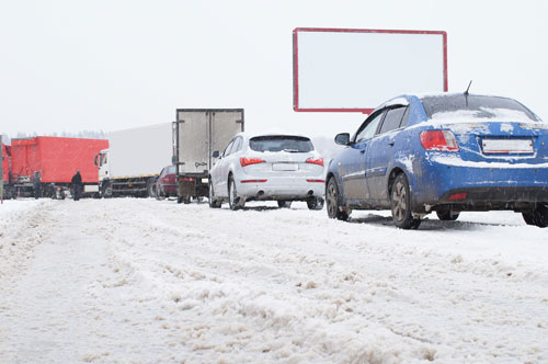 Should you evacuate or shelter in place? Cars Driving in snowstorm